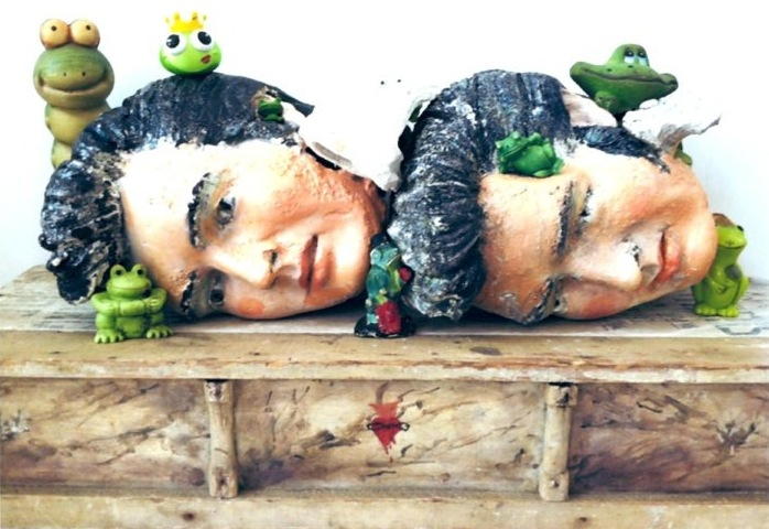 Croaked Double Elvis, 2012, painted plaster on artist's shelf, with embellishments and found objects, 13 x 33 x 11 1/2 inches.